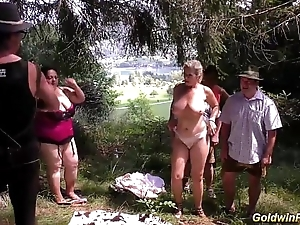 Lederhosen Group sex in nature