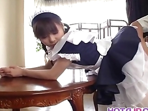 Pretty Asian maid Natsumi exposes hot pussy be advisable for fingering