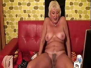 Horny granny plays with milk. Discern here at 747cams.com