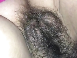 This chab cums on her hairy muff