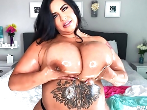 Sexy BBW oils her immense soul and plays with them